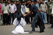 Участники митинга против смертной казни. Фото: Andrew Biraj / Reuters