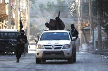 Боевики ИГ в городе Дейр-эз-Зор. Фото: Khalil Ashawi / Reuters