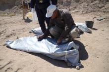 Эксгумация останков в Тикрите. Фото: Reuters