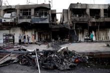 Останки машины и последствия взрыва на рынке Багдада. Фото: Khalid Mohammed / АР