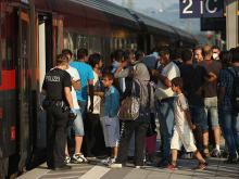 Мигранты, прибывшие из Венгрии в Германию. 31 августа 2015 года. Getty Images. Фото: Ш.Гэллап