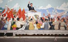 Стена с изображением Ким Ир Сена в Пхеньяне. Фото Reuters с сайта РБК