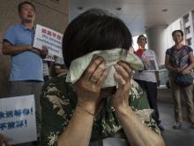Родственники пассажиров рейса MH370 в Пекине, Китай. Август 2015 года. Getty Images. Фото: К.Фраер