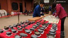 Серебряные слитки из сокровищ Чжан Сяньчжуна, найденные в реке Миньцзян. Фото: Xinhua / Li He