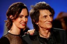 Ронни Вуд с женой Салли Хамфрис. Фото: Mark Blinch / Reuters