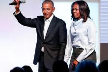 Барак и Мишель Обама. Фото: Kamil Krzaczynski / Reuters