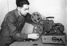Слесарь-сборщик з-да «Кинап» Виктор Ботяй за регулировкой нового аппарата ПУ-16-1. Одесса, 1957 г. (1105)
